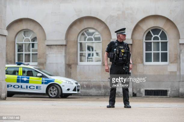 An armed police officer stands on patrol in Horse Guards Parade on May 23 2017 in London England 22 people including children have been killed and 59...