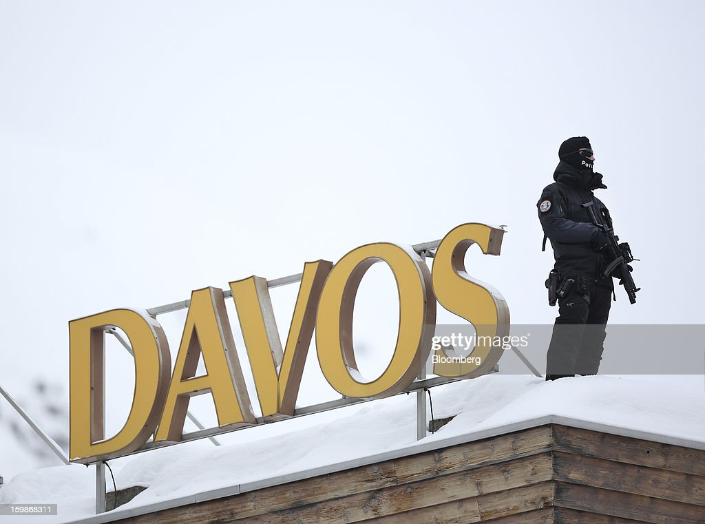 An armed police officer stands on the snow-covered rooftop of the Hotel Davos and looks out over the Congress Center, the venue for the World Economic Forum (WEF) in Davos, Switzerland, on Tuesday, Jan. 22, 2013. World leaders, Influential executives, bankers and policy makers arrive in the Swiss Alps for the 43rd annual meeting of the World Economic Forum in Davos, the five day event runs from Jan. 23-27. Photographer: Jason Alden/Bloomberg via Getty Images