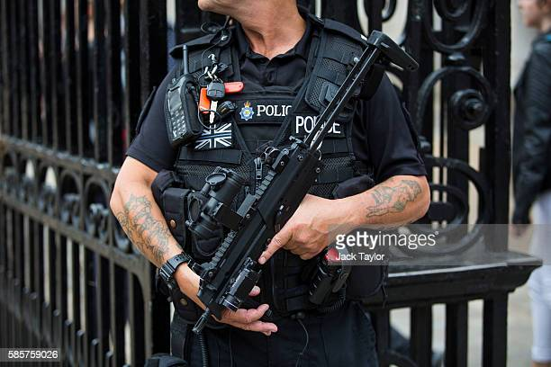 An armed police officer stands outside Horse Guards on Whitehall on August 4 2016 in London England Six people were attacked by a 19 year old man...
