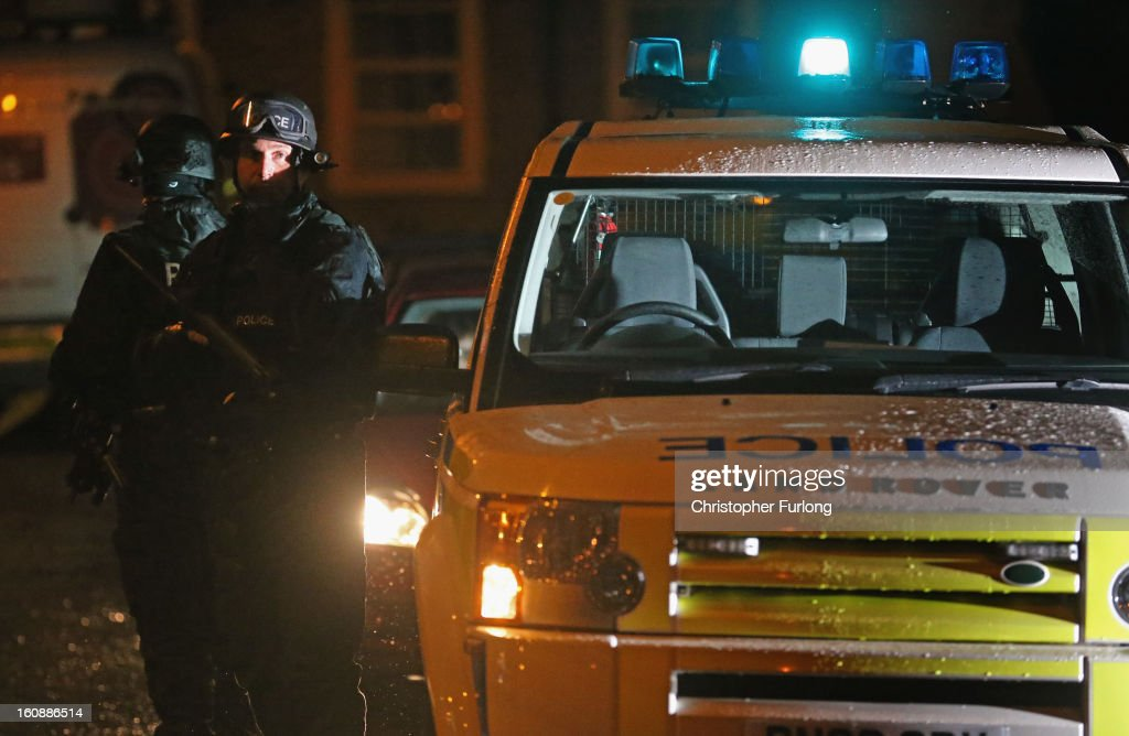 An armed policeman stands guard as Dale Cregan and nine other co-defendants leave Preston Crown Court in a prison van after the first day of their trial facing charges of murder and attempted murder on February 7, 2013 in Preston, Lancashire. Dale Cregan, 29, stands accused of four murders, including PC Nicola Hughes and PC Fiona Bone on September 18, 2012 and also in two separate attacks earlier this year of Mark Short and his father David Short. Cregan is also being charged with an additional four counts of attempted murder.