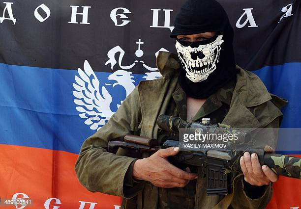 An armed proRussian fighter poses at a checkpoint near the eastern Ukranian city of Slavyansk on May 10 2014 Tensions were running at fever pitch in...