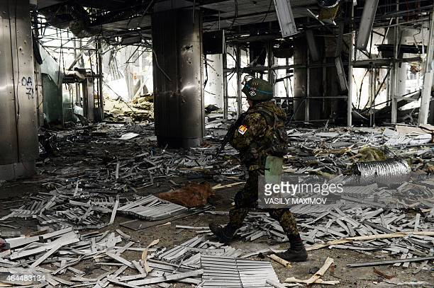 An armed rebel fighter walks inside a destroyed airport building in the eastern Ukrainian city of Donetsk on February 26 2015 Ukraine's military said...