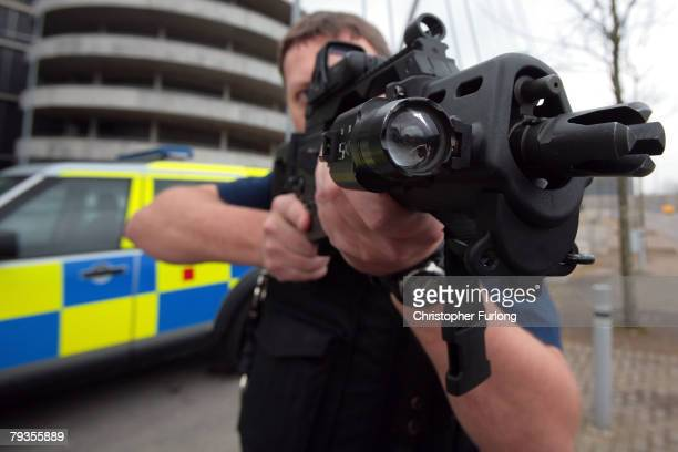 An armed response officer from Greater Manchester Police poses with a Heckler and Koch G36 assualt rifle during the first ever Vanguard Conference a...