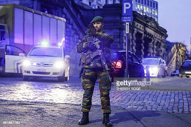 An armed soldier holds up his hand as heavy security measures were deployed all around the Palace of Justice in Brussels on January 21 2015 for the...