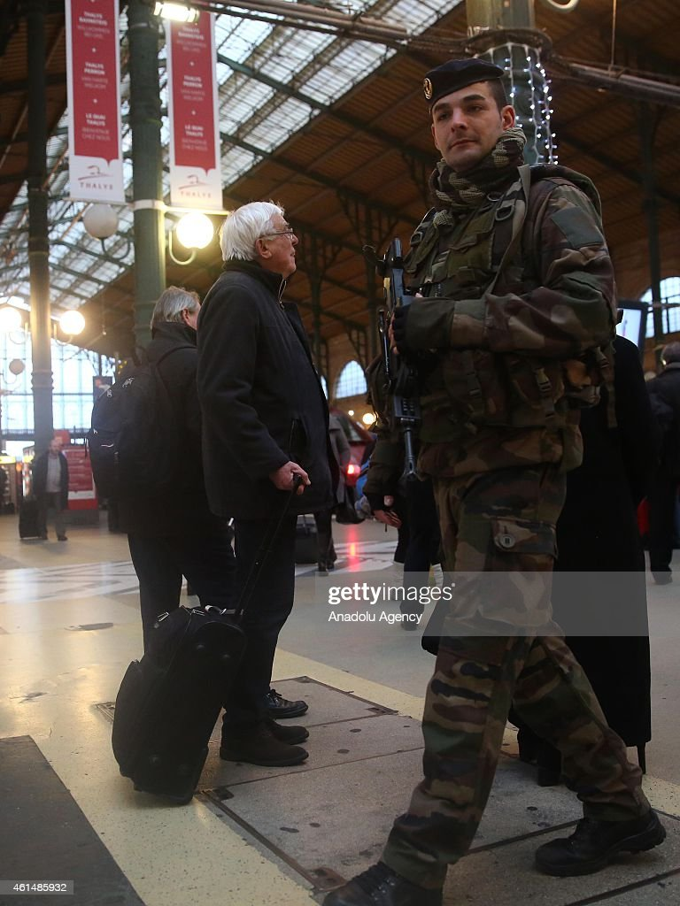 An armed soldier patrols at the Gare du Nord railway station in Paris France on January 132015 after the France terror attacks