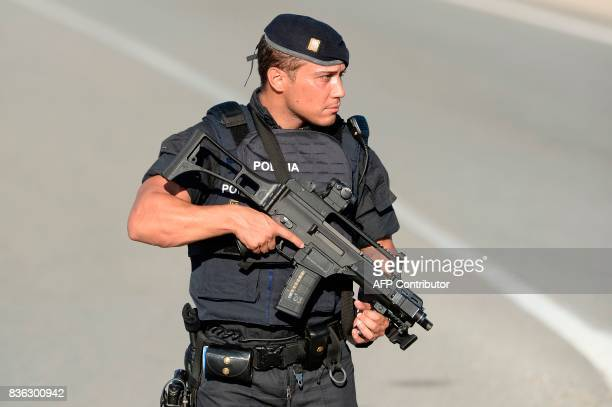 An armed Spanish policeman stands guard at the site where Moroccan suspect Younes Abouyaaqoub was shot on August 21 2017 near Sant Sadurni d'Anoia...