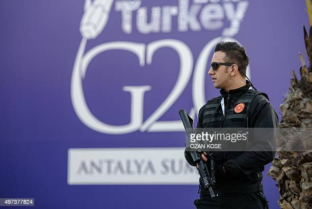 An armed special force policeman guards the entrance of the media headquaters at the G20 Summit at Belek during the G20 Turkey Leaders Summit on...