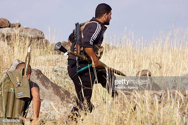 An armed Syrian opponent prepares to takes his position in the Nahta region of Daraa Syria on May 15 2015 as they attack regime forces