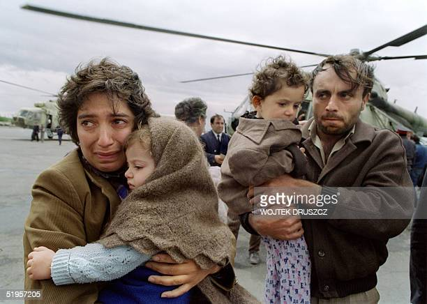 An Armenian family fleeing ethnic tension in the predominantly Armenian enclave of NagornyKarabakh in Azerbaijan arrives at Yerevan airport 13 May...