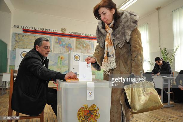 An Armenian woman casts her ballot at a poling station in Yerevan on February 18 2013 Armenians voted today in presidential elections already marred...