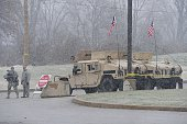 An armored military Humvee of the Missouri National Guard sits at a perimeter post outside a Target department store offering support to the Missouri...