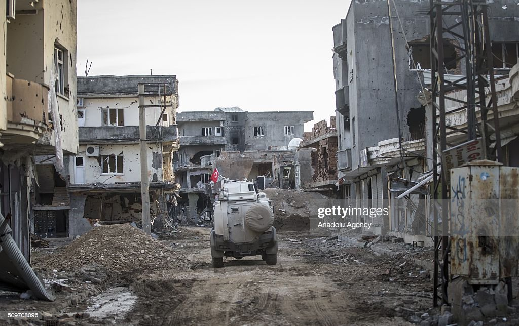 An armored Turkish security force vehicle patrols a street where PKK heavily damaged whole neighborhood, after counter-terror operation in Cizre, the southeastern Turkish town that has seen fighting rage between security forces and PKK terrorists finished, on February 12, 2016.