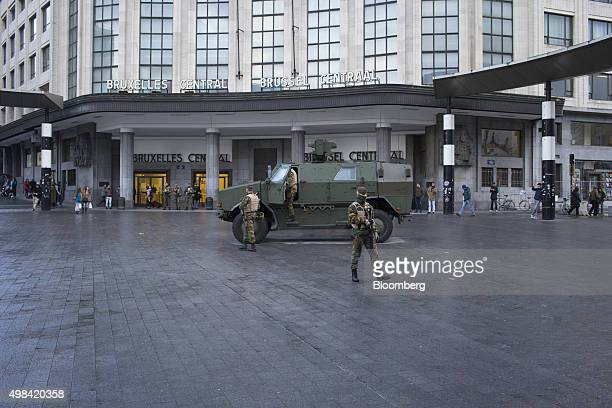 An armored vehicle stands a soldiers patrol outside Brussels central railway station in Brussels Belgium on Sunday Nov 22 2015 The search for a key...