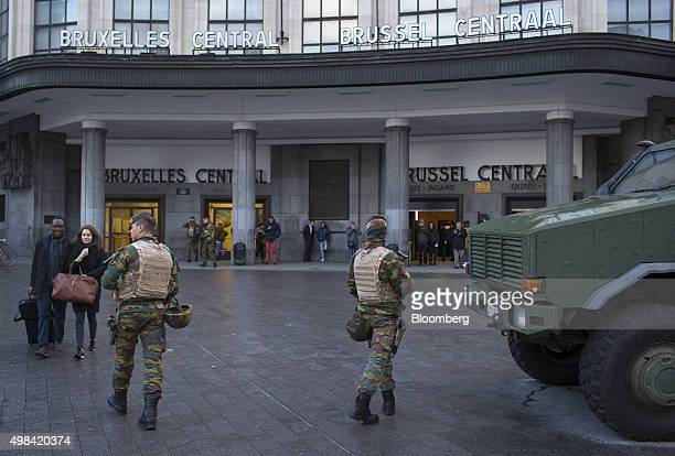 An armored vehicle stands as soldiers patrol outside Brussels central railway station in Brussels Belgium on Sunday Nov 22 2015 The search for a key...