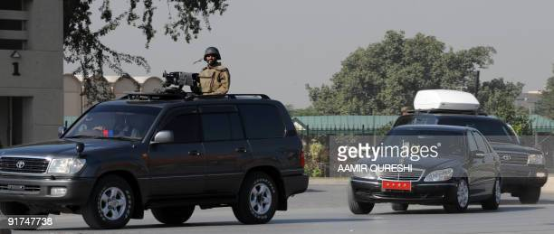An armoured convoy escorts the car carrying Pakistan�s Army Chief General Ashfaq Kayani as he leaves after a visit to army headquarters in Rawalpindi...