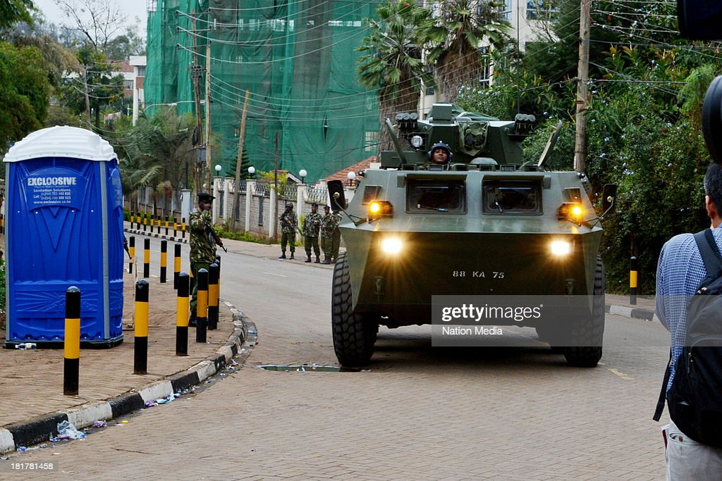 An armoured Military truck patrolling outside Westgate Mall on September 24, 2013 in Nairobi, Kenya. The terrorist attack occurred on Saturday, 10-15 gunmen from the extremist group Al-Shabab entered the mall and opened fire at random on shoppers; 68 deaths have been confirmed.