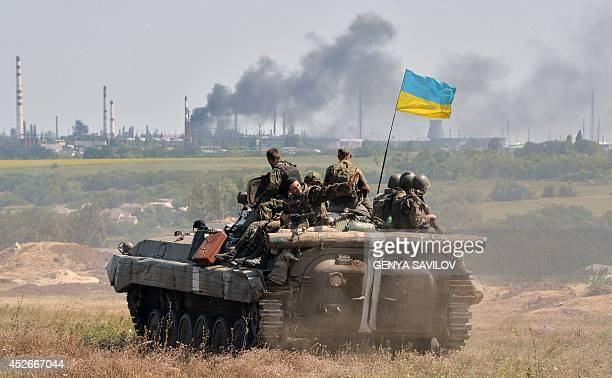 An armoured personnel carrier flying Ukraine's flag from a convoy of the Ukrainian forces drives towards the eastern Ukrainian city of Lysychansk in...