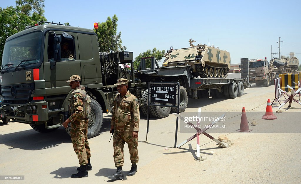 An armoured personnel carrier is transported as Pakistan soldiers set off for their deployment points from the Malir Cantonment ahead of parliamentary elections in Karachi on May 3, 2013. Pakistan will deploy more than 600,000 security personnel during next week's general election to guard against Taliban attacks that have marred campaigning. The May 11 polls will mark the first time that a civilian government has completed a full five-year term and handed over to an elected successor, in a country ruled by the military for half its 66-year history.