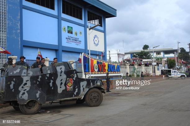 An armoured truck is positioned in front of a police station in Jolo Sulu on the southern Philippine Island of Mindanao on July 16 2017 / AFP PHOTO /...