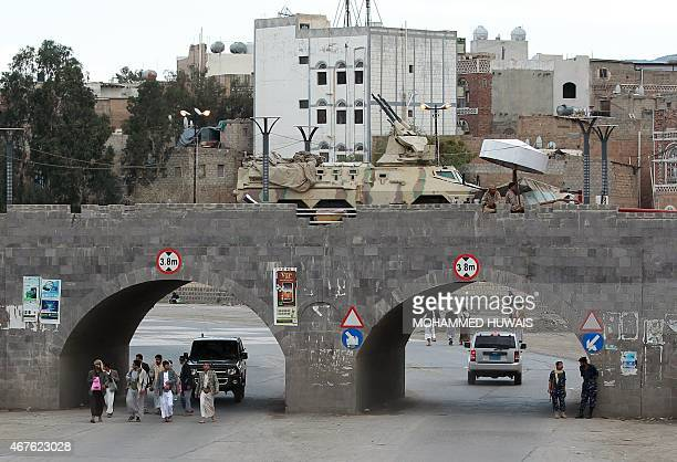 An armoured vehicle mounted with antiaircraft guns is stationed near the defence ministry in Sanaa on March 26 as tribal gunmen gather to protest...