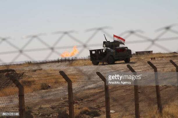 An armoured vehicle of Iraqi forces enters the Bai Hassan oil facility after Peshmerga forces withdrawn the area in Kirkuk Iraq on October 17 2017