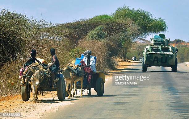 An armoured vehicle of the African Union peacekeeping force patrols the streets of Kismayo on November 15 2016 Somalia is in the process of selecting...