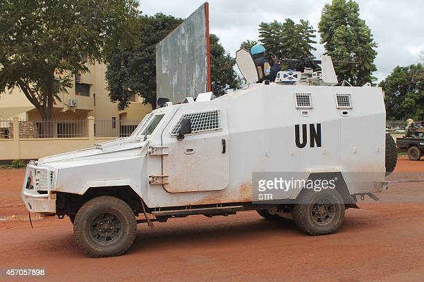 An armoured vehicle of the UN peacekeeping mission in Central African Republic patrols in downtown Bangui on October 11 2014 The UN Security Council...