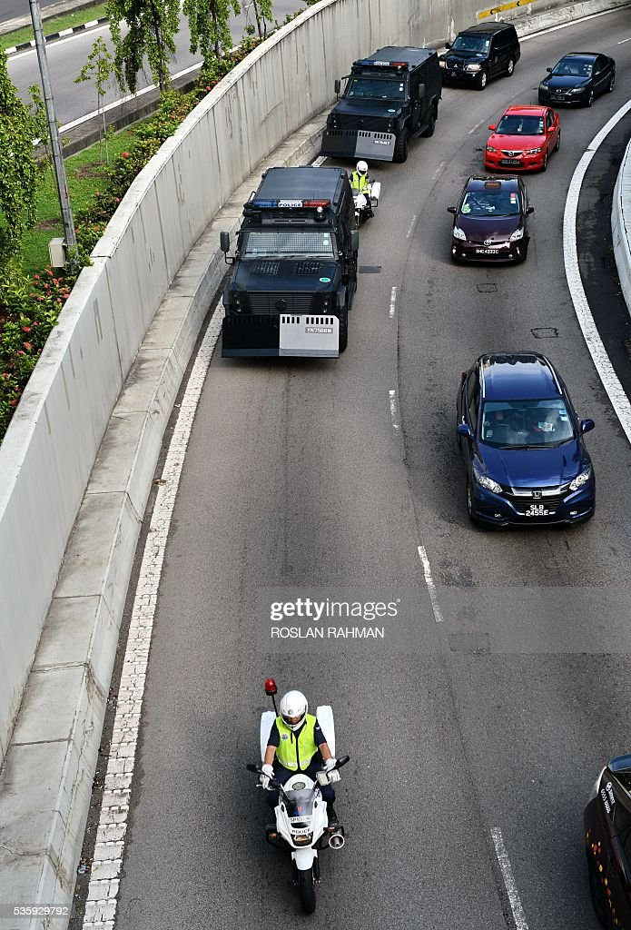 An armoured vehicle transporting six arrested Bangladeshi guest workers arrives to the State court in Singapore on May 31, 2016. The six Bangladeshi guest workers will be convicted and sentence for raising funds for an alleged plot to launch terrorist attacks in their homeland. / AFP / ROSLAN
