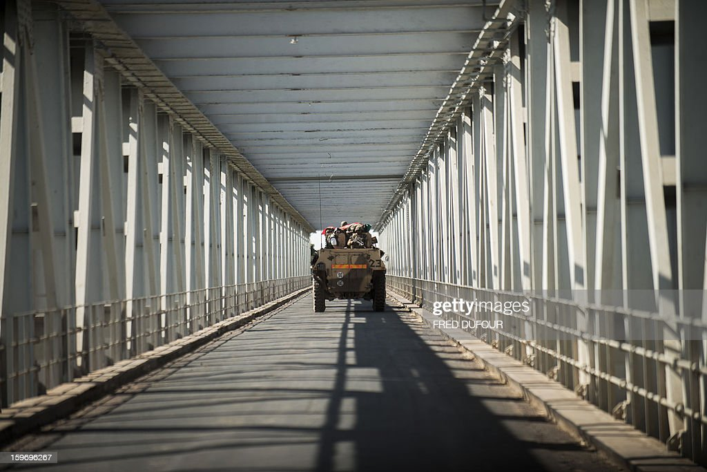 An armoured vehicule carrying journalists embedded with French soldiers in Mali passes through a bridge in Markala, on January 18, 2013. France now has 1,800 troops on the ground in Mali, inching closer to the goal of 2,500 it plans to deploy in its African former colony, Defence Minister Jean-Yves Le Drian said today. That was 400 more than a day earlier, said the minister as he met with French special forces in the western port of Lorient. The troops have been sent to help the Malian army regain control of the north from Islamist groups.