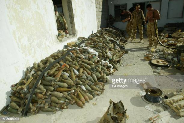An arms cache discovered on the outskirts of Abu Al Khasib containing more than two hundred rocket propelled grenades Members of 49 Field Squadron...
