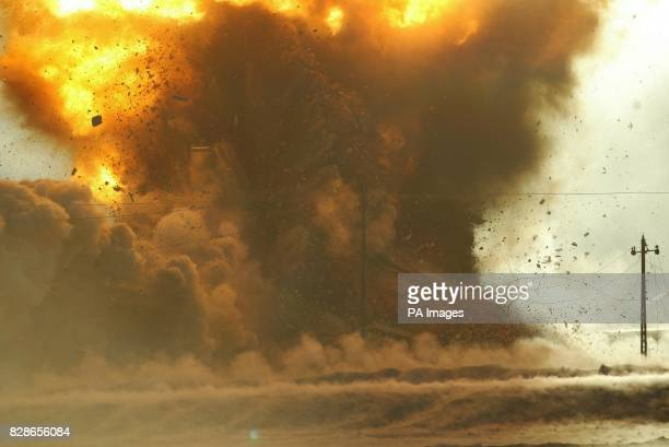 An arms cache discovered on the outskirts of Abu Al Khasib containing more than two hundred rocket propelled grenades is destroyed by members of 49...