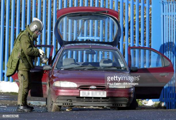 An army bomb disposal expert walks towards a suspect car which was left close to a Catholic girls school in North Belfast one of a series of bomb...