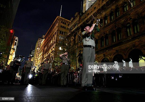 An Army bugler plays the last post at a dawn service for Anzac Day April 25 2005 in Sydney Australia Australians and New Zealanders are today...