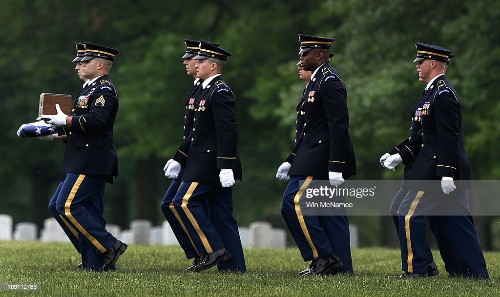 An Army burial team carries an urn containing the remains of Sergeant First Class James F. Grissom during a burial service at Arlington National Cemetery May 20, 2013 in Arlington, Virginia. Grissom, from Hayward, California, died from wounds suffered in combat in Paktika province, Afghanistan.