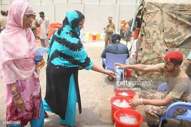 An Army doctor treats a patient who was affected by the heatwave at heat stroke centre in Karachi Pakistan on June 25 2015 More than 1000 people have...