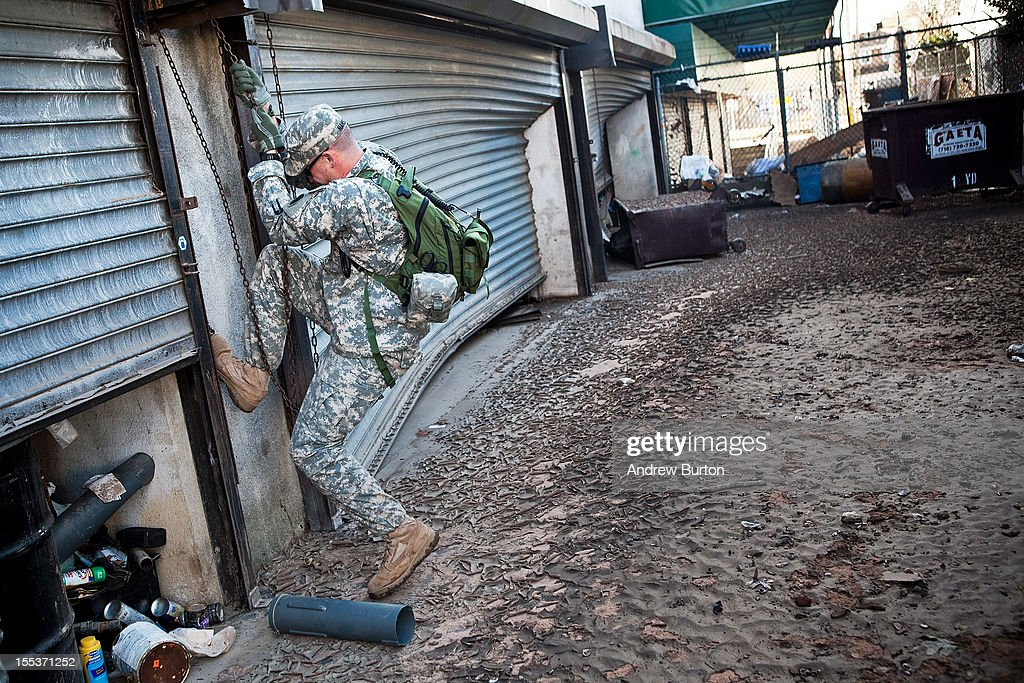 An Army National Guard soldier attempts to raise the garage door on a storage supply for a survivor in the Midland Beach neighborhood of Staten Island on November 3, 2012 in New York City. As clean up efforts from Superstorm Sandy continue, colder weather and another storm predicted for next week are beginning to make some worried.