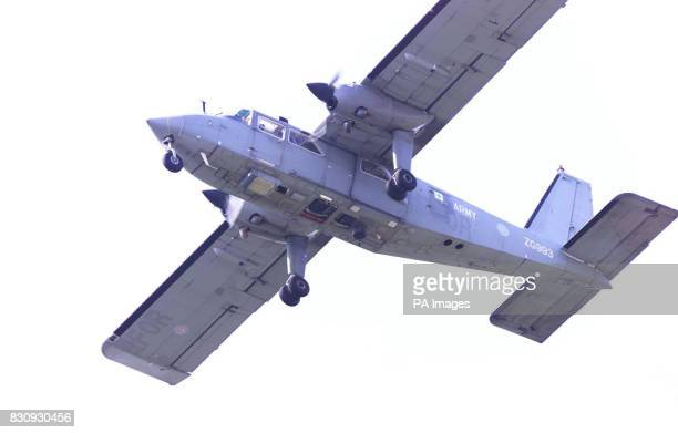 An army reconnaissance aircraft flies low over the area of the house of Kevin Huntley father of Ian Huntley in search for the missing girls in...