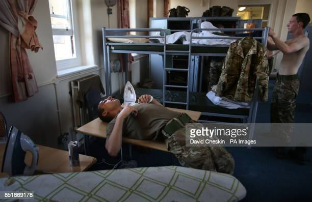An Army Reserve recruit rests in his room after taking part in a cross country run exercise in the Pentland Hills near Edinburgh testing their skill...