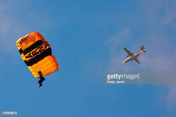 An Army skydiver dives into the track during pre race ceremonies as the plane flies overhead prior to the NASCAR Nextel Cup Series Banquet 400 on...