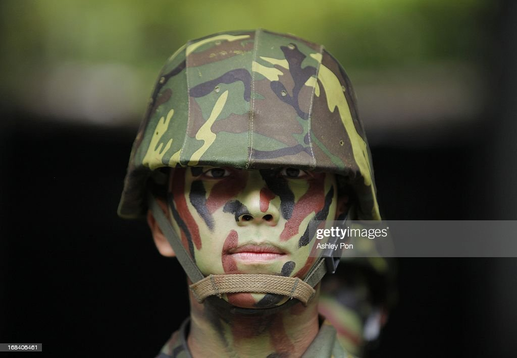 An army Soldier stands guard during the Howitzer drill as part of their routine military training in Nangan on May 8, 2013 in Matsu, Taiwan. The military held a routine drill on the unnamed base on the island which was opened up to the press by the Ministry of National Defence.