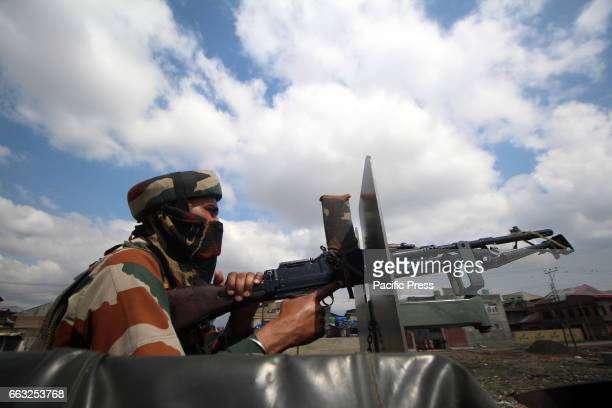An army trooper standing alert on armored vehicle after the suspected militants carried out an ambush on their convoy in Bemina area of Srinagar in...