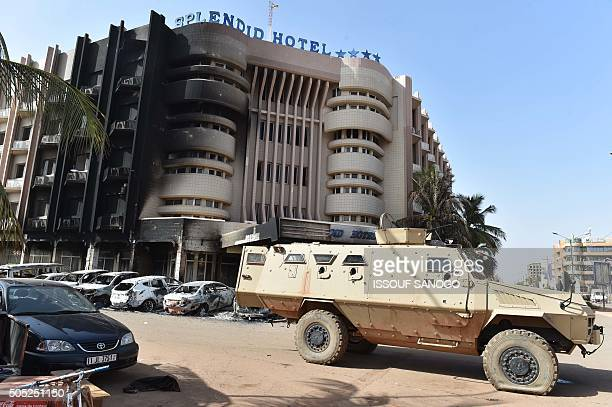 An army vehicle is parked outside the damaged Splendid Hotel and nearby Cappuccino restaurant following a jihadist attack in Ouagadougou on January...