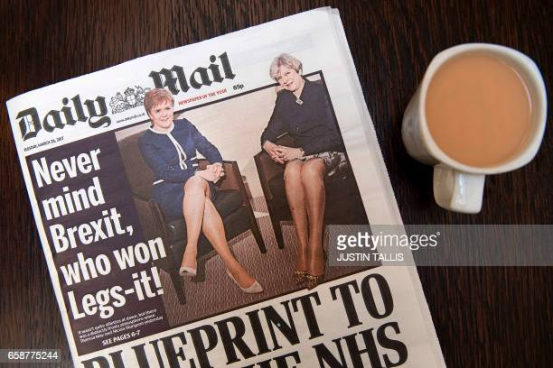 An arranged photograph shows a copy of today's Daily Mail newspaper pictured in a coffee shop in central London on March 28 featuring on its front...