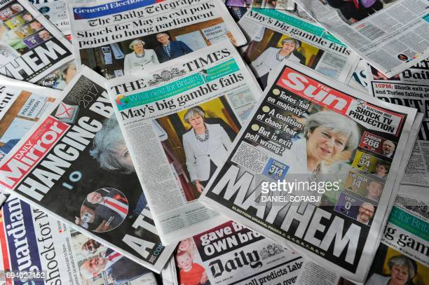 An arrangement of British daily newspapers are photographed as an illustration in London on June 9 2017 showing front page stories about the exit...