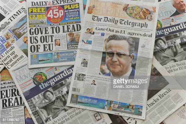 An arrangement of British newspapers taken in London on February 20 2016 show front page headlines regarding an agreement on reforming Britain's EU...