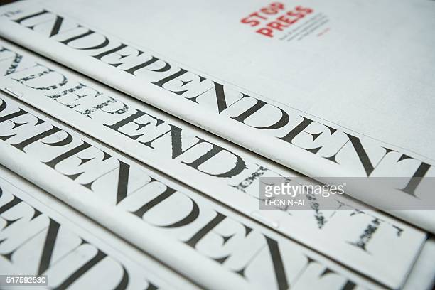An arrangement of copies of the final print edition of the Independent newspaper shows a supplement featuring an adapted masthead reading 'The End'...
