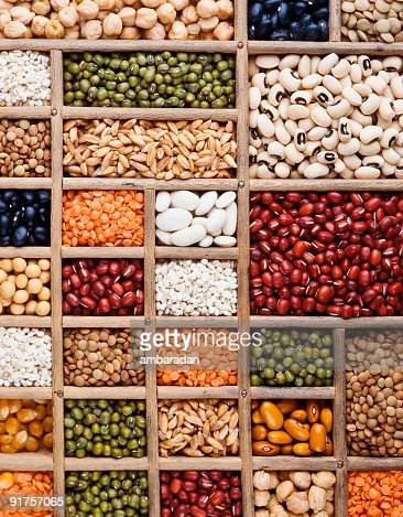 An arrangement of grain, seeds and legumes on a wooden box
