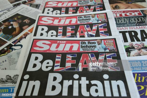 An arrangement of newspapers pictured in London on June 14 2016 shows the front page of the Sun daily newspaper with a headline urging readers to...
