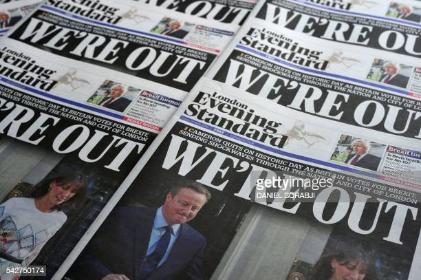 An arrangement of newspapers pictured in London on June 24 as an illustration shows the front page of the London Evening Standard newpaper reporting...