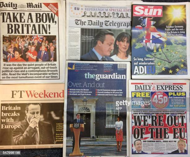 An arrangement of newspapers pictured in London on June 25 as an illustration shows the front pages of the English newpapers reporting the...